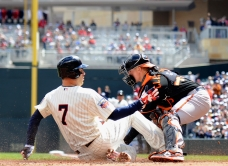 MINNEAPOLIS, MN - MAY 3: Joe Mauer #7 of the Minnesota Twins slides safely as Steve Clevenger #45 of the Baltimore Orioles defends home plate during the first inning of the game on May 3, 2014 at Target Field in Minneapolis, Minnesota. (Photo by Hannah Foslien/Getty Images)