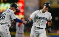 SEATTLE, WA - SEPTEMBER 16: Jesus Montero #63 of the Seattle Mariners is congratulated by third base coach Rich Donnelly #26 after hitting a three-run home run against the Los Angeles Angels of Anaheim in the fourth inning at Safeco Field on September 16, 2015 in Seattle, Washington. (Photo by Otto Greule Jr/Getty Images)