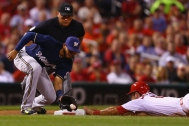ST. LOUIS, MO - SEPTEMBER 25: Matt Carpenter #13 of the St. Louis Cardinals steals third base against Luis Sardinas #10 of the Milwaukee Brewers in the first inning at Busch Stadium on September 25, 2015 in St. Louis, Missouri. (Photo by Dilip Vishwanat/Getty Images)
