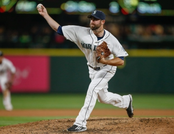 SEATTLE, WA - OCTOBER 03: Relief pitcher Tony Zych #55 of the Seattle Mariners pitches against the Oakland Athletics in the fourth inning at Safeco Field on October 3, 2015 in Seattle, Washington. (Photo by Otto Greule Jr/Getty Images)