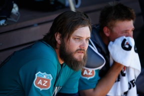 PEORIA, AZ - MARCH 10: Starting pitcher Wade Miley #20 of the Seattle Mariners sits in the dugout before the spring training game against the Chicago Cubs at Peoria Stadium on March 10, 2016 in Peoria, Arizona. (Photo by Christian Petersen/Getty Images)