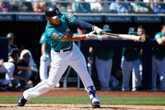 PEORIA, AZ - MARCH 10: Stefen Romero #17 of the Seattle Mariners hits a two RBI double against the Chicago Cubs during the first inning of the spring training game at Peoria Stadium on March 10, 2016 in Peoria, Arizona. (Photo by Christian Petersen/Getty Images)