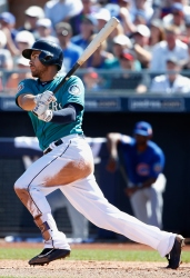 PEORIA, AZ - MARCH 10: Stefen Romero #17 of the Seattle Mariners hits a RBI single against the Chicago Cubs during the second inning of the spring training game at Peoria Stadium on March 10, 2016 in Peoria, Arizona. (Photo by Christian Petersen/Getty Images)