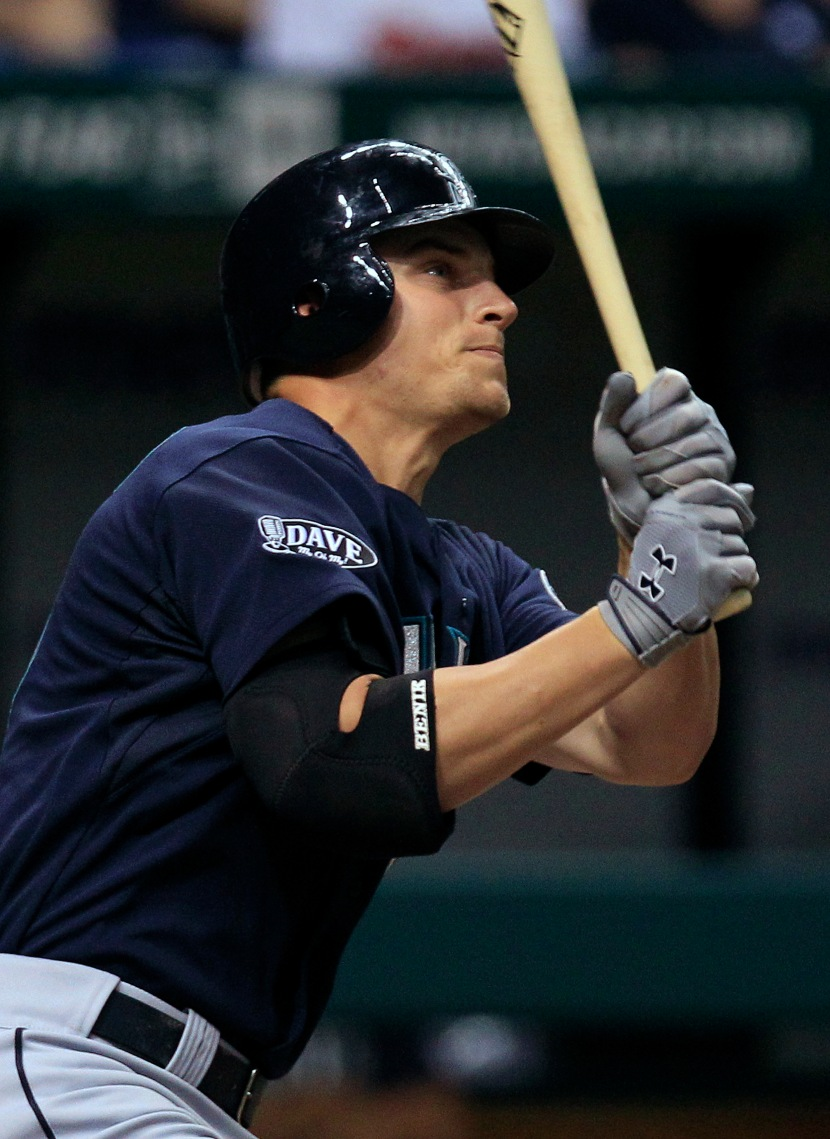Seattle Mariners' Kyle Seager follows his home run off Tampa Bay Rays starting pitcher Wade Davis during the seventh inning of a baseball game Friday, Aug. 19, 2011, in St. Petersburg, Fla. (AP Photo/Chris O'Meara)