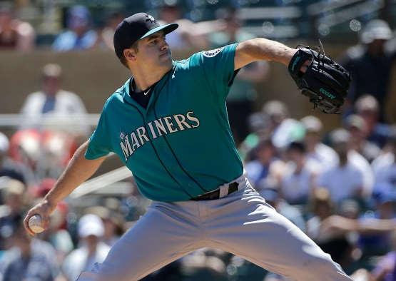 Seattle Mariners starting pitcher Nathan Karns throws during the first inning of a spring training baseball game against the Colorado Rockies in Scottsdale, Ariz., Saturday, April 2, 2016. (AP Photo/Jeff Chiu)