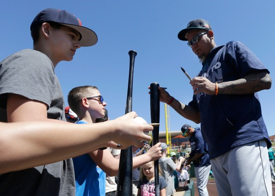 Seattle Mariners starting pitcher Felix Hernandez signs autographs before a spring training baseball game between the Colorado Rockies and the Mariners in Scottsdale, Ariz., Saturday, April 2, 2016. (AP Photo/Jeff Chiu)