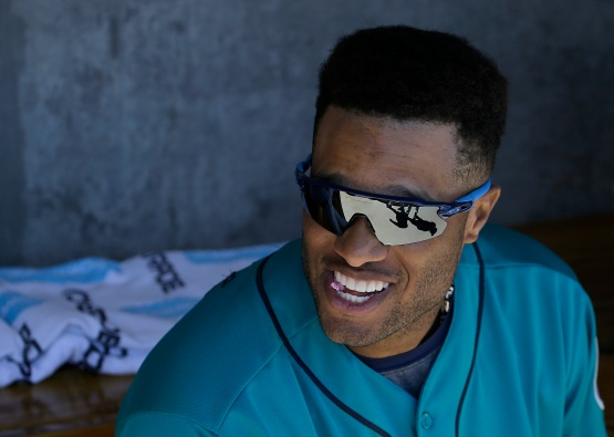 Seattle Mariners second baseman Robinson Cano smiles in the dugout before a spring training baseball game between the Colorado Rockies and the Mariners in Scottsdale, Ariz., Saturday, April 2, 2016. (AP Photo/Jeff Chiu)