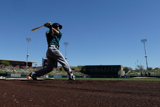 Seattle Mariners' Nori Aoki swings in the on-deck circle before the first inning of a spring training baseball game against the Colorado Rockies in Scottsdale, Ariz., Saturday, April 2, 2016. (AP Photo/Jeff Chiu)