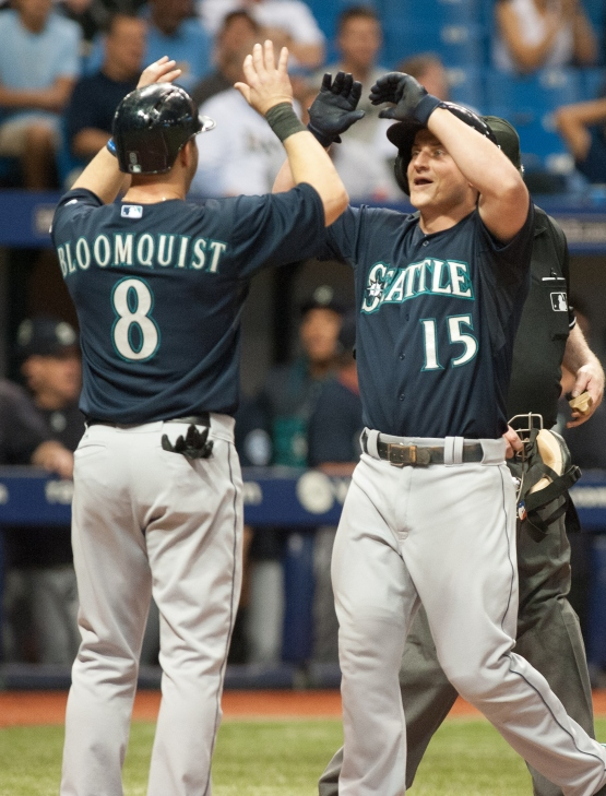 ST. PETERSBURG, FL - MAY 26: Kyle Seager #15 of the Seattle Mariners celebrates his grand slam with teammate Willie Bloomquist #8 of the Seattle Mariners in the eighth inning against the Tampa Bay Rays on May 26, 2015 at Tropicana Field in St. Petersburg, Florida. (Photo by Cliff McBride/Getty Images) *** Local Caption ***Kyle Seager;Willie Bloomquist