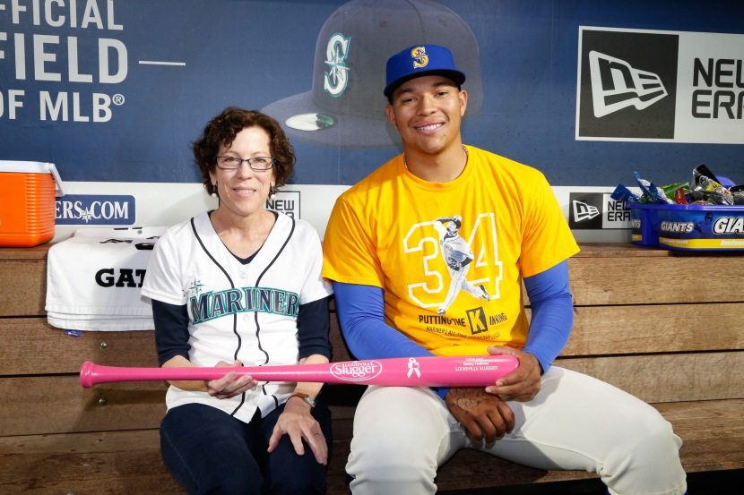Honorary Bat Girl Betsy Haffner and pitcher Taijuan Walker with her personalized Louisville Slugger pink bat.