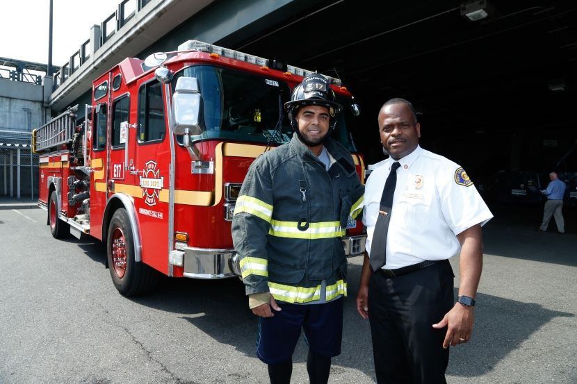 Nelson Cruz and Seattle Fire Chief Harold Scoggins.