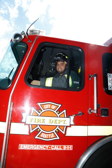 Nelson Cruz hops into the driver's seat of an engine from Seattle Fire Station 17.