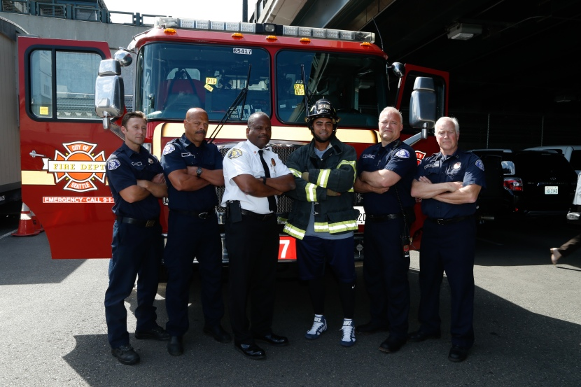 Nelson Cruz poses with Seattle Fire Fighters and Chief Harold Scoggins. The photo will be part of a social media campaign to help SFD win a $10,000 Medic One grant.