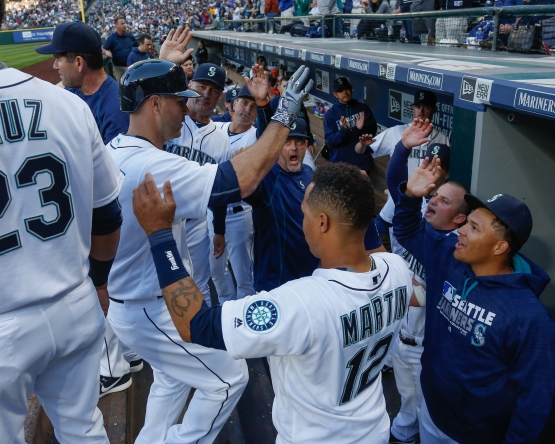 SEATTLE, WA - APRIL 09:  Chris Iannetta #33 of the Seattle Mariners is congratulated by teammates after hitting a home run in the second inning against the Oakland Athletics at Safeco Field on April 9, 2016 in Seattle, Washington.  (Photo by Otto Greule Jr/Getty Images)