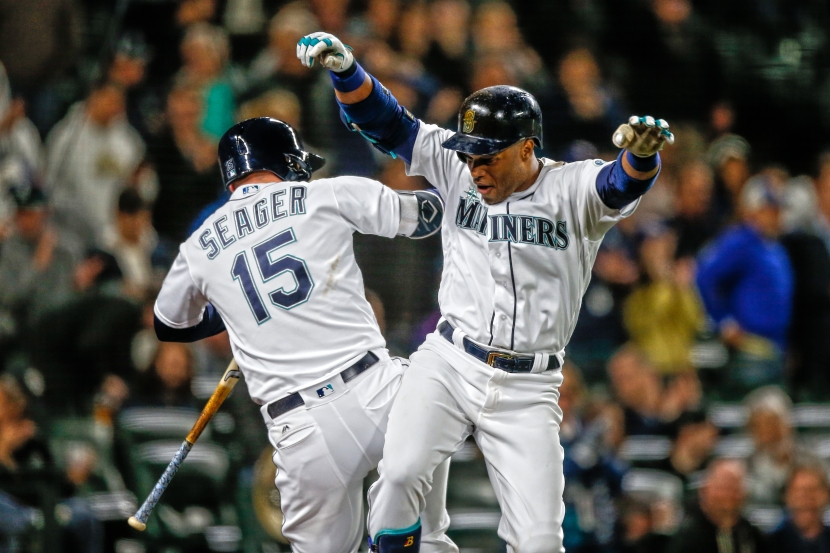 SEATTLE, WA - MAY 25: Robinson Cano #22 of the Seattle Mariners is congratulated by Kyle Seager #15 after hitting a solo home run against the Oakland Athletics in the eighth inning at Safeco Field on May 25, 2016 in Seattle, Washington. (Photo by Otto Greule Jr/Getty Images)
