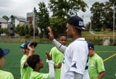Robinson Cano visiting with members of the Rainier Vista Boys & Girls Club in Seattle.
