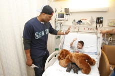 Robinson Cano visiting a patient at Seattle Children's Hospital during a Seattle Mariners Get Well Tour.