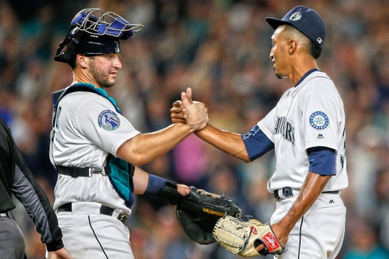 SEATTLE, WA - AUGUST 06: Closing pitcher Edwin Diaz #39 of the Seattle Mariners is congratulated by catcher Mike Zunino #3 after defeating the Los Angeles Angels of Anaheim 8-6 at Safeco Field on August 6, 2016 in Seattle, Washington. (Photo by Otto Greule Jr/Getty Images)