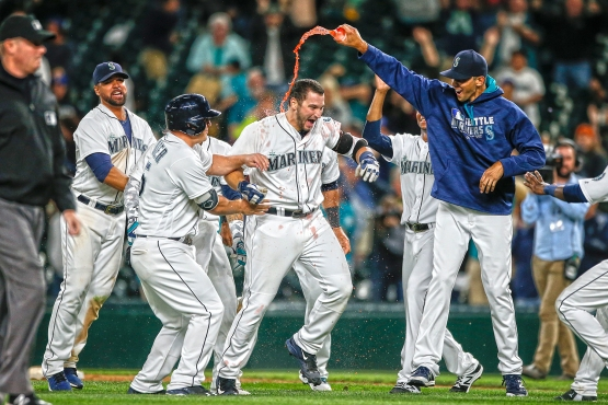 SEATTLE, WA - AUGUST 09: Mike Zunino #3 of the Seattle Mariners is doused by teammates after getting the game-winning hit in the fifteenth inning to beat the Detroit Tigers at Safeco Field on August 9, 2016 in Seattle, Washington. (Photo by Otto Greule Jr/Getty Images)
