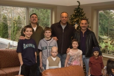 Julio Cruz, with Rick Rizzs and Dave Valle, at Seattle Ronald McDonald House during a Toys for Kids holiday gift party.